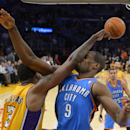 Oklahoma City Thunder power forward Serge Ibaka, right, of Congo, is hit in the face after rejecting the shot of Los Angeles Lakers power forward Shawne Williams, left, during the second half of an NBA basketball game, Thursday, Feb. 13, 2014, in Los Ange