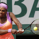 Serena Williams of the U.S. returns the ball to Germany's Anna-Lena Friedsam during their second round match of the French Open tennis tournament at the Roland Garros stadium, Thursday, May 28, 2015 in Paris. Williams won 5-7, 6-3, -6-3. (AP Photo/Francois Mori)