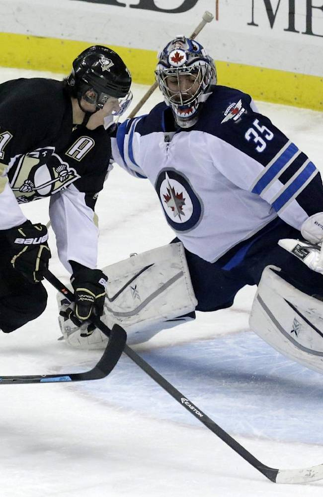 Pittsburgh Penguins' Evgeni Malkin (71) cannot get to a rebound in front of Winnipeg Jets goalie Al Montoya (35) during the first period of an NHL hockey game in Pittsburgh, Sunday, Jan. 5, 2014