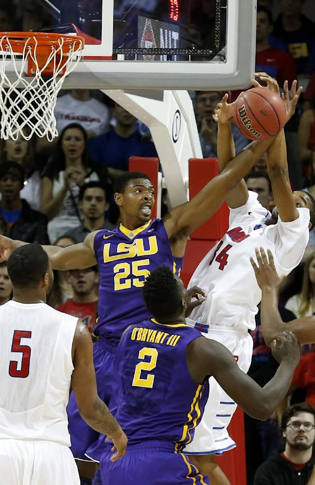 LSU forward Jordan Mickey (25) and SMU forward Ben Moore (34) fight for a rebound during the first half of an NCAA college basketball game in the second round of the NIT Monday, March 24, 2014, in Dallas, Texas