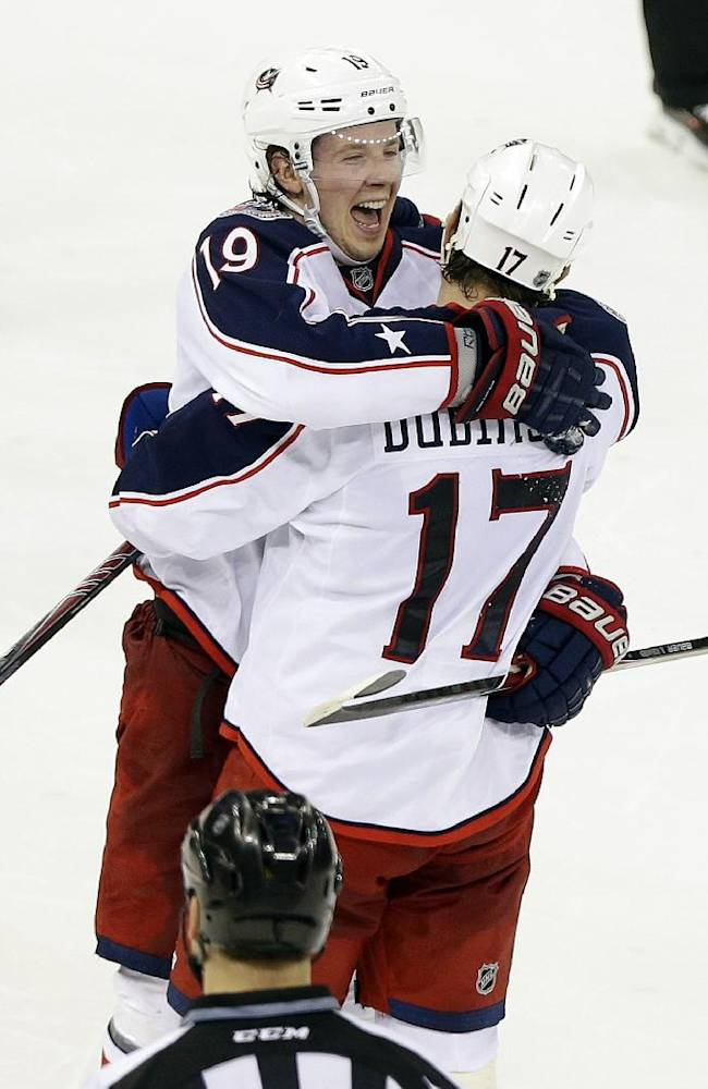 Columbus Blue Jackets center Ryan Johansen (19) celebrates with teammate Brandon Dubinsky (17) after scoring the game winning goal during the shootout period of an NHL hockey game against the New York Rangers Monday, Jan. 6, 2014, in New York. The Blue Jackets won the game 4-3 in a shootout