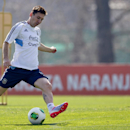 Argentina's Lionel Messi kicks the ball during a training session ahead of the team's 2014 World Cup qualifying soccer match against Paraguay, in Buenos Aires, Argentina, Friday, Sept. 6, 2013. (AP Photo/Natacha Pisarenko)