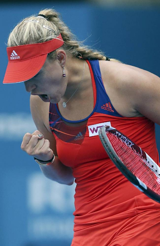 Angelique Kerber of Germany clenches her fist as she reacts to winning the first set of her semi finals match against Madison Keys of the U.S. during the Sydney International Tennis Tournament in Sydney, Australia, Thursday, Jan. 9, 2014
