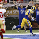 St. Louis Rams tight end Lance Kendricks catches a 22-yard touchdown pass ahead of San Francisco 49ers cornerback Perrish Cox (20) in the first quarter of an NFL football game Monday, Oct. 13, 2014, in St Louis The Associated Press