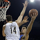Oklahoma City Thunder power forward Nick Collison, right, shoots against New Orleans Pelicans center Jason Smith (14) in the first half of an NBA basketball game in New Orleans, Friday, Dec. 6, 2013 The Associated Press