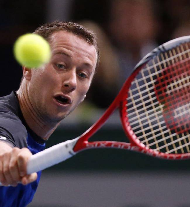 Philipp Kohlschreiber of Germany returns the ball to Roger Federer of Switzerland during their round of eight match, at the Paris Masters tennis at Bercy Arena in Paris, France, Thursday, Oct. 31, 2013