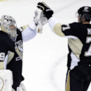 Pittsburgh Penguins goalie Marc-Andre Fleury (29) celebrates with Evgeni Malkin (71) after stopping 26 shots in a 3-1 win over the Calgary Flames during an NHL hockey game in Pittsburgh Friday, Dec. 12, 2014 The Associated Press
