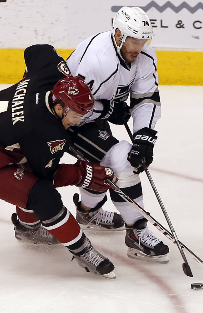 Phoenix Coyotes' Zbynek Michalek (4), of the Czech Republic, battles Los Angeles Kings' Dwight King (74) for the puck during the second period of an NHL hockey game on Tuesday, Oct. 29, 2013, in Glendale, Ariz