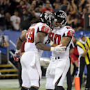 Atlanta Falcons running back Steven Jackson (39) celebrates his touchdown with teammate Atlanta Falcons Levine Toilolo (80)during the second half of an NFL football game against the Buffalo Bills on Sunday, Dec. 1, 2013, in Toronto The Associated Press
