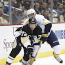 Pittsburgh Penguins' Patric Hornqvist (72) brings the puck around the net as Nashville Predators' Seth Jones (3) defends in the second period of an NHL hockey game, Sunday, Feb. 1, 2015 in Pittsburgh The Associated Press