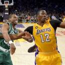 FILE - Boston Celtics center Jason Collins battles Los Angeles Lakers center Dwight Howard (12) for a rebound during the first half of their NBA basketball game, Wednesday, Feb. 20, 2013 in Los Angeles. NBA veteran center Collins has become the first male professional athlete in the major four American sports leagues to come out as gay. Collins wrote a first-person account posted Monday, April 29, 2013 on Sports Illustrated's website.(AP Photo/Mark J. Terrill, File)