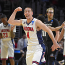 Arizona guard T.J. McConnell reacts after beating Xavier 68-60 in a college basketball regional semifinal in the NCAA Tournament, Thursday, March 26, 2015, in Los Angeles. (AP Photo/Mark J. Terrill)