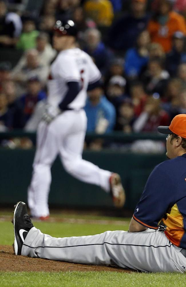 Houston Astros relief pitcher Matt Albers sits on the ground as Atlanta Braves' Freddie Freeman runs to first in the fourth inning of a spring training baseball game, Friday, Feb. 28, 2014, in Kissimmee, Fla. Freeman hit the ball back to Albers who was not injured on the play. The Astros won 7-5