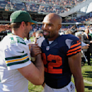 Green Bay Packers quarterback Aaron Rodgers (12) greets Chicago Bears running back Matt Forte (22) after their NFL football game Sunday, Sept. 28, 2014, in Chicago. The Packers won 38-17. The Associated Press