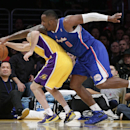 Los Angeles Clippers' Glen Davis, right, and Los Angeles Lakers' Jordan Farmar fight for a loose ball during the first half of an NBA basketball game on Thursday, March 6, 2014, in Los Angeles The Associated Press