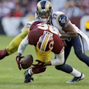 Washington Redskins tight end Jordan Reed (86) cannot pull in a pass from quarterback Colt McCoy under pressure from St. Louis Rams cornerback Trumaine Johnson (22) during the second half of an NFL football game in Landover, Md., Sunday, Dec. 7, 2014 The