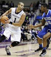 Northwestern guard Drew Crawford (1) looks to pass as Eastern Illinois forward Keenen Anderson guards during the first half of an NCAA college basketball game in Evanston, Ill., on Saturday, Nov. 9, 2013. (AP Photo/Nam Y. Huh)