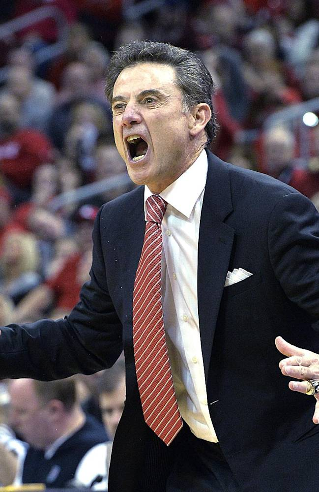 Louisville's head coach Rick Pitino shouts instructions to his team during the first half of an NCAA college basketball game Sunday Jan. 12, 2014, in Louisville, Ky