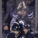Winnipeg Jets' Andrew Ladd (16) and Blake Wheeler (26) celebrate Wheeler's goal against Colorado Avalanche's goaltender Semyon Varlamov (1) during first period NHL hockey action in Winnipeg, Manitoba, on Thursday, Dec. 12, 2013 The Associated Press