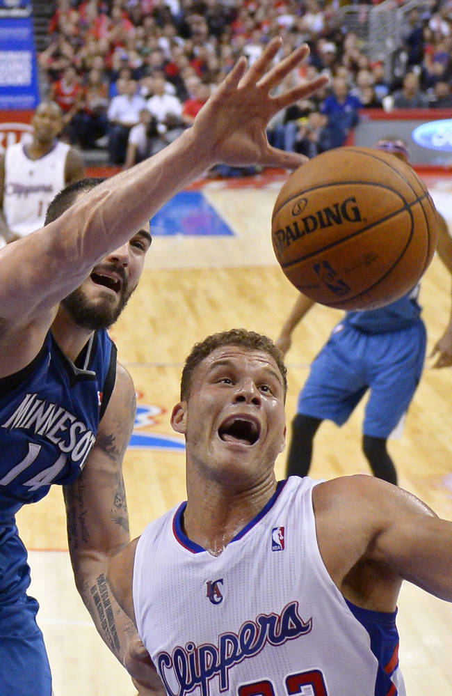 Minnesota Timberwolves center Nikola Pekovic, left, of Montenegro, and Los Angeles Clippers forward Blake Griffin battle for a rebound during the second half of an NBA basketball game, Monday, Nov. 11, 2013, in Los Angeles. The Clippers won 109-107