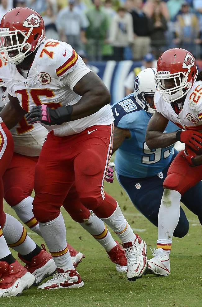 Kansas City Chiefs running back Jamaal Charles (25) follows the block of tackle Branden Albert (76) to score a touchdown against the Tennessee Titans on a 1-yard run in the fourth quarter of an NFL football game on Sunday, Oct. 6, 2013, in Nashville, Tenn