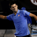 Novak Djokovic of Serbia celebrates the match point after defeating Stan Wawrinka of Switzerland in their semifinal match at the Australian Open tennis championship in Melbourne, Australia, Friday, Jan. 30, 2015. (AP Photo/Bernat Armangue)