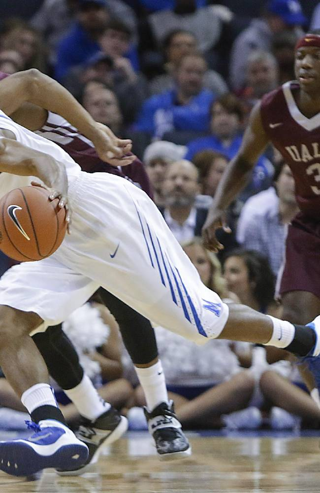 Memphis guard Geron Johnson takes the ball down court against Arkansas-Little Rock guards Leroy Isler, back, and Josh Hagins (3) in the first half of an NCAA college basketball game on Friday, Dec. 13, 2013, in Memphis, Tenn