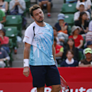 Stanislas Wawrinka of Switzerland reacts after losing a point against Tatsuma Ito of Japan during their first round match of Japan Open Tennis Championships in Tokyo, Tuesday, Sept. 30, 2014. (AP Photo/Shizuo Kambayashi)