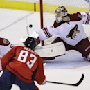 Phoenix Coyotes goalie Mike Smith (41) deflects the puck shot by Washington Capitals Jay Beagle (83) as Coyotes' Derek Morris (53) defends during the second period of an NHL hockey game, Saturday, March 8, 2014, in Washington The Associated Press