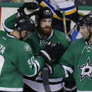 Dallas Stars Jordie Benn (24) celebrates his goal with teammates Jason Spezza (90) and Erik Cole (72) during the third period of an NHL pre-season hockey game against the St. Louis Blues, Monday, Sept. 22, 2014, in Dallas. The Stars won 4-3 The Associated