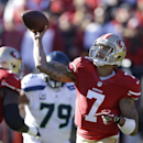 San Francisco 49ers quarterback Colin Kaepernick throws the ball as Seattle Seahawks defensive end Red Bryant (79) looks on in the first half of an NFL football game on Sunday, Dec. 8, 2013, in San Francisco The Associated Press