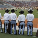 Members of the Texas Cowboys watch Texas' spring NCAA college football game, Saturday, March 30, 2013, in Austin, Texas. (AP Photo/Eric Gay)