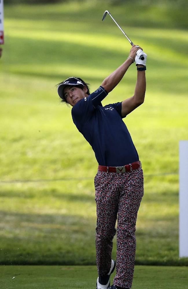 Ryo Ishikawa, of Japan, watches his tee shot on the 15th hole during the first round of play at The Barclays golf tournament Thursday, Aug. 21, 2014, in Paramus, N.J