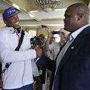 Carolina Panthers' Cam Newton, left, congratulates Travelle Wharton at Wharton's retirement news conference during an NFL football practice at their training camp in Spartanburg, S.C., Tuesday, July 29, 2014 The Associated Press