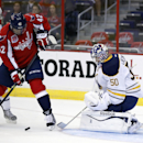 Washington Capitals right wing Joel Ward (42) works the puck in front of the goal as he is defended by Buffalo Sabres defenseman Chad Ruhwedel (5) and goalie Nathan Lieuwen (50) in the first period of a preseason NHL hockey game, Sunday, Sept. 21, 2014, i