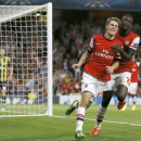 Arsenal's Aaron Ramsey, left, celebrates his second goal against Fenerbahce with teammate Yaya Sanogo during their Champions League qualifying play-off second leg soccer match at Emirates Stadium, London, Tuesday, Aug. 27, 2013. (AP Photo/Kirsty Wigglesworth)