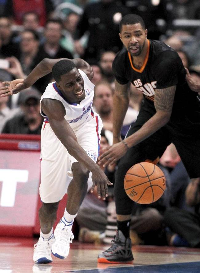 Phoenix Suns forward Marcus Morris, right, knocks the ball away from Los Angeles Clippers guard Darren Collison, left, during the second half of an NBA basketball game Monday, March 10, 2014, in Los Angeles. Clippers won 112-105