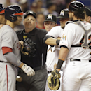 Home plate umpire Marty Foster, center, separates Washington Nationals' Ian Desmond, left, from Miami Marlins catcher Jarrod Saltalamacchia, right, during the fourth inning of the MLB National League baseball game, Tuesday, April 15, 2014, in Miami. Desm
