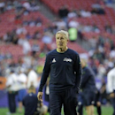 Seattle Seahawks head coach Pete Carroll watches as players warm up before the NFL Super Bowl XLIX football game against the New England Patriots on Sunday, Feb. 1, 2015, in Glendale, Ariz The Associated Press