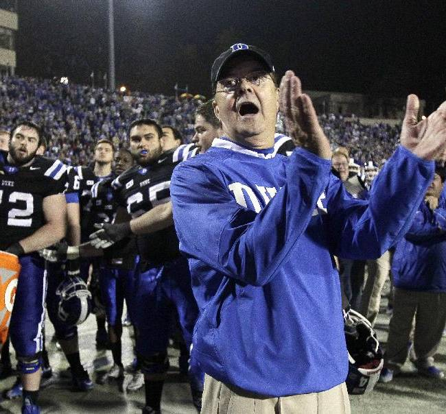 In this Nov. 16, 2013 file photo, Duke coach David Cutcliffe watches from the sidelines during the second half of an NCAA college football game against Miami in Durham, N.C. Florida State quarterback Jameis Winston is the Atlantic Coast Conference's rookie of the year and Cutcliffe is its coach of the year for the second straight season. The league also announced Tuesday, Dec. 3, 2013,  that Virginia Tech cornerback Kendall Fuller is its defensive rookie of the year