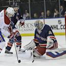 New York Rangers goalie Henrik Lundqvist, right, defends the net against Montreal Canadiens right wing Dale Weise, left, during the first period of an NHL hockey game Thursday, Jan. 29, 2015 at Madison Square Garden in New York. (AP Photo/Mary Altaffer)