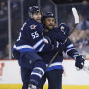 Winnipeg Jets' Mark Scheifele (55) and Dustin Byfuglien (33) celebrate Byfuglien's second goal against the Chicago Blackhawks, during the second period of an NHL hockey game Sunday, March 29, 2015, in Winnipeg, Manitoba. (AP Photo/The Canadian Press, John Woods)