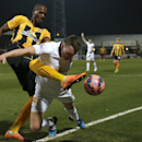 Manchester United's Phil Jones, right, heads the ball down under pressure form Cambridge United's Tom Elliott during their English FA Cup fourth round soccer match between Cambridge United and Manchester United, in Cambridge, England, Friday, Jan. 23, 201