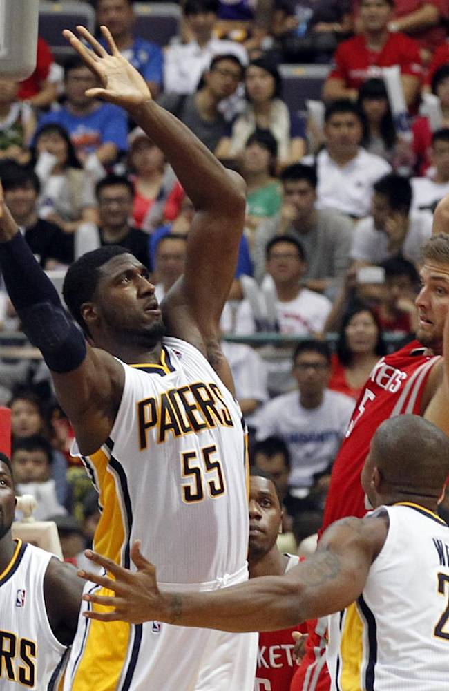 NBA Indiana Pacers Roy Hibbert (55) tries to block Houston Rockets Chandler Parsons, right, during a preseason game in Taipei, Taiwan, Sunday, Oct. 13, 2013. The Rockets beat the Pacers 107-98