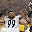 In this Dec. 22, 2013, file photo, Pittsburgh Steelers' Brett Keisel celebrates after an NFL football game against the Green Bay Packers in Green Bay, Wis. The Steelers are planning to re-sign defensive end Keisel to bolster a reconfigured line that has s
