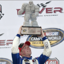 Tyler Reddick hoists the trophy in Victory Lane after he won the NASCAR Truck series auto race, Friday, May 29, 2015, at Dover International Speedway in Dover, Del. (AP Photo/Nick Wass)