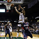 Milwaukee Bucks' Ramon Sessions (13) blocks a shot by Atlanta Hawks' Dennis Schroder (17) during the first half of an NBA basketball game on Wednesday, April 16, 2014, in Milwaukee The Associated Press