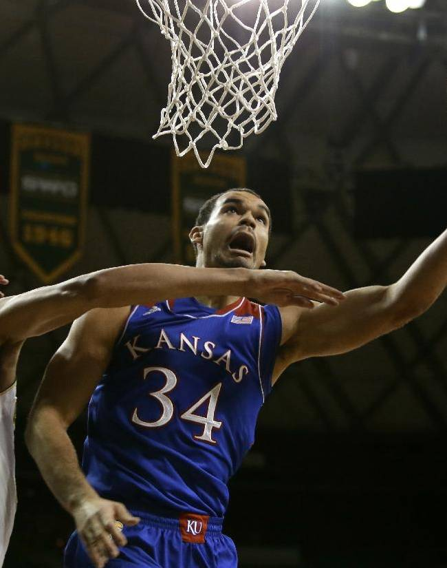 Baylor's Isaiah Austin (21) fouls Kansas' Perry Ellis (34) as Ellis goes up for a shot attempt in the first half of an NCAA college basketball game, Tuesday, Feb. 4, 2014, in Waco, Texas
