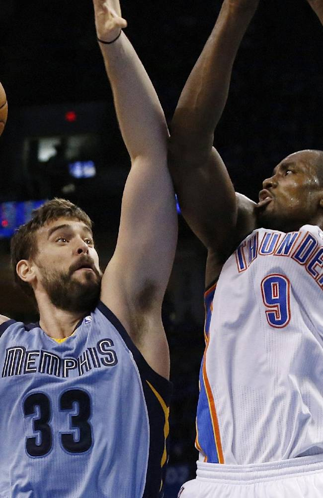 Memphis Grizzlies center Marc Gasol (33) shoots as Oklahoma City Thunder forward Serge Ibaka (9) defends in the second quarter of Game 2 of an opening-round NBA basketball playoff series in Oklahoma City, Monday, April 21, 2014