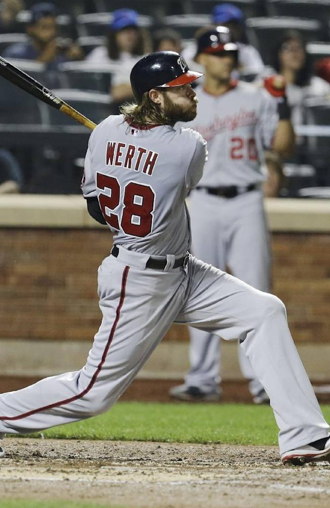 Washington Nationals' Jayson Werth  follows through on an RBI double during the third inning of a baseball game against the New York Mets on Tuesday, Sept. 10, 2013, in New York